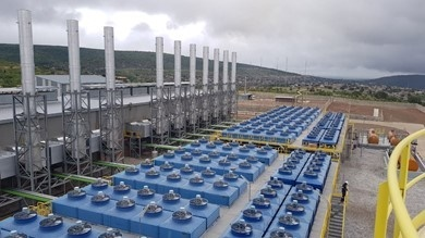 A view of the power plant with the  ill of Ressano Garcia as background